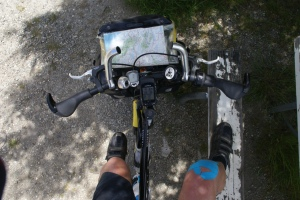 So, part from the amazing scenery, what do I spend my time looking at? Especially working hard uphill? Map, GPS computer, handlebars and taped-up knee..