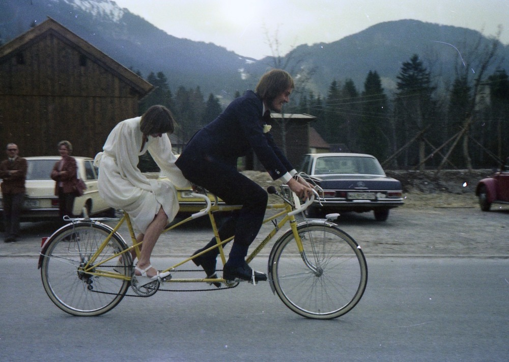 Our first tandem, being test-ridden in Oberammergau in our wedding finery, March 25 21977.