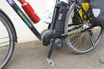 """This especially for Bill Mitchell. Close-up view of my bike, with Bosch motor and battery (takes 6 hours to charge), handy stand, excellent brakes, 28"""" wheels. Seriously well made, and a pre-Brexit bargain at £1500 (£3000 the pair, with Jutta's step-through.)"""
