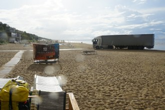 What on earth is a lorry doing on the beach!