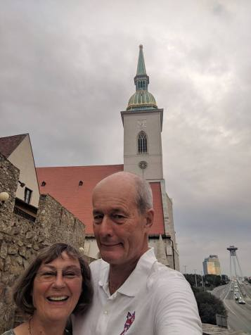 Arm = selfie stick in Bratislava, with Europe's most shocking motorway through the heart of the old town. Thanks 1970s Communist planners, making a point